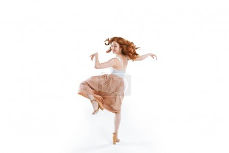 Photo for Young smiling red haired woman spinning around isolated on white - Royalty Free Image