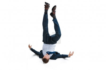 Businessman in suit falling upside down