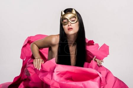 Photo for Sensual woman in devil mask in pink paper flower isolated on white - Royalty Free Image