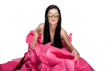 Woman in gold painted sunglasses