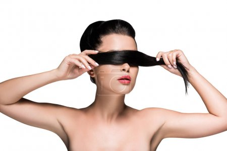 Woman covering eyes with ponytail