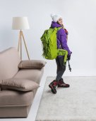 young hiker in warm clothing with backpack ready to travel