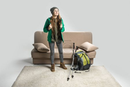 attractive hiker in warm clothing with backpack ready to travel