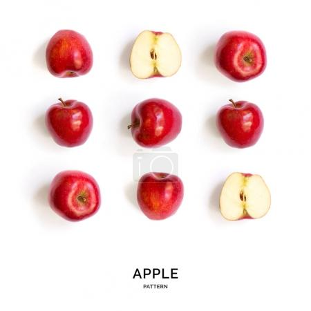 Photo for Tropical abstract background. Red apple fruits on the white background. - Royalty Free Image
