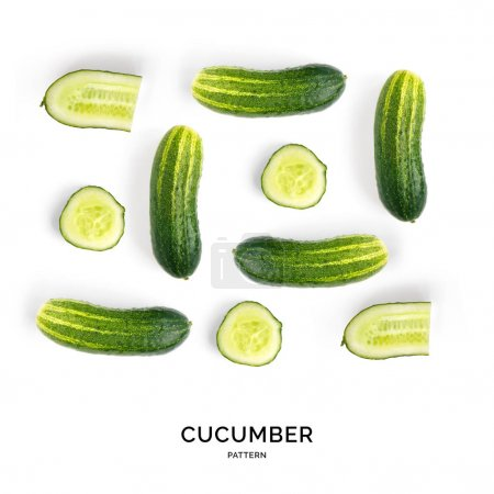 Photo for Simplistic pattern of fresh sliced and whole cucumbers laid out symetrically in square shape on white background. - Royalty Free Image