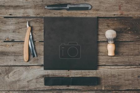 shaving equipment on wooden tabletop