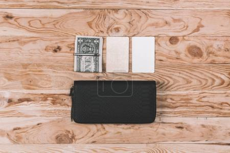 Clutch bag with dollars and blank notes