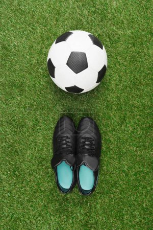 soccer ball with black boots