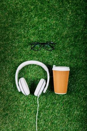 Headphones and coffee to go