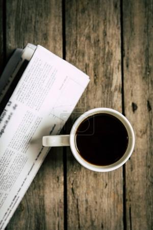 Photo for Top view of cup of coffee and newspaper - Royalty Free Image