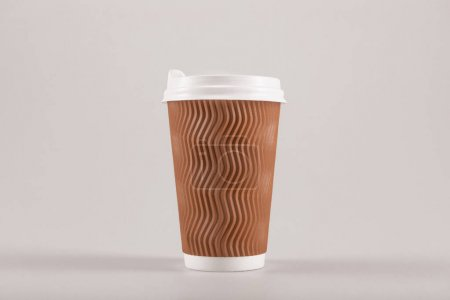 Photo for Cardboard disposable coffee cup isolated on beige, coffee to go concept - Royalty Free Image