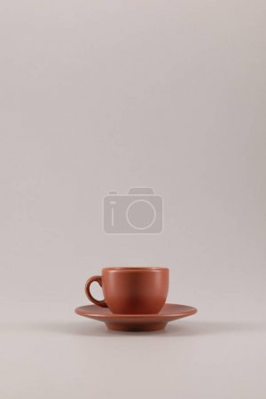 Photo for One ceramic coffee cup on saucer isolated on beige with copy space - Royalty Free Image