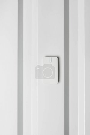 Photo for Electronic door lock on white wall, home security concept - Royalty Free Image