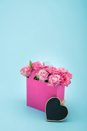 Roses in paper box with heart