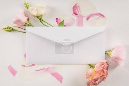 Beautiful flowers and white envelope