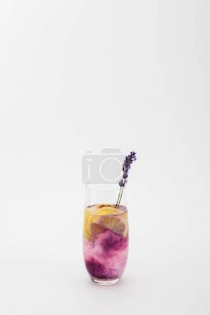Photo for Homemade summertime lemonade with lavender and lemon pieces in glass isolated on white - Royalty Free Image