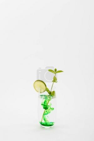Photo for Homemade refreshing drink with lime and mint twig in glass isolated on white - Royalty Free Image