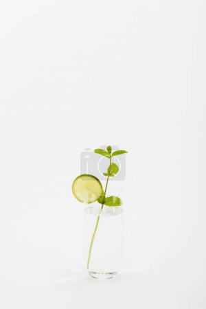 Photo for Homemade refreshing drink with lime and mint twig isolated on white - Royalty Free Image