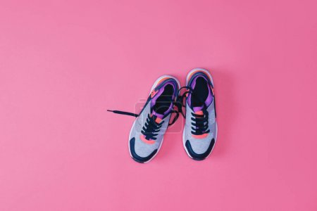 Photo for Top view of pair of sneakers for fitness isolated on pink - Royalty Free Image