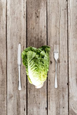 fresh letuce salad and cutlery