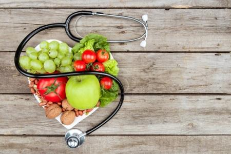 Top view of stethoscope,various organic vegetables...