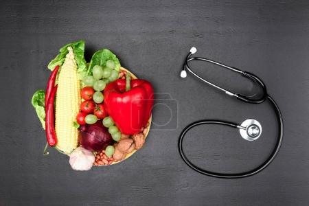 Photo for Top view of stethoscope,various organic vegetables and fruits isolated on grey, clean eating concept - Royalty Free Image