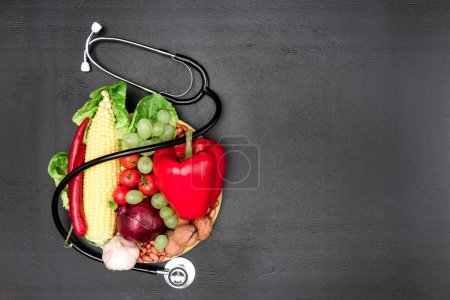 stethoscope, organic vegetables and fruits