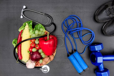 Photo for Flat lay with stethoscope, organic food and sport equipment isolated on grey, healthy lifestyle concept - Royalty Free Image