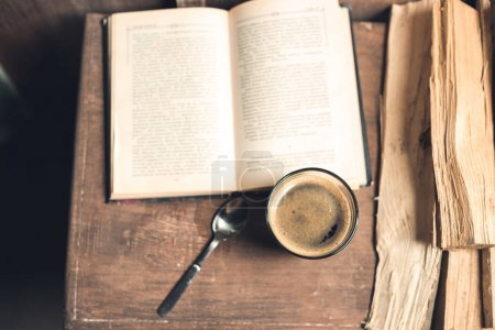 Glass of coffee, old book