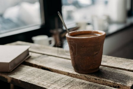 Clay cup of coffee with milk