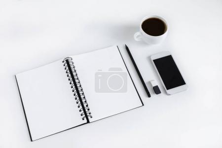 Empty notepad and smartphone
