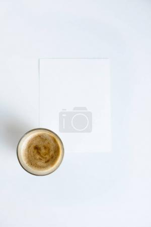 Cup of coffee on white paper