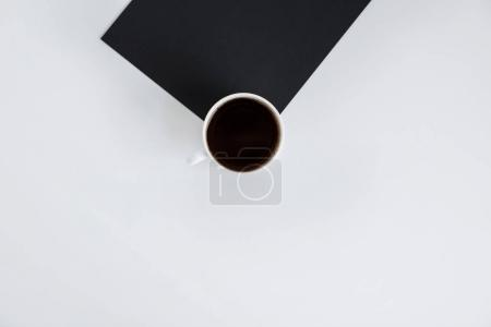 Cup of coffee on black paper