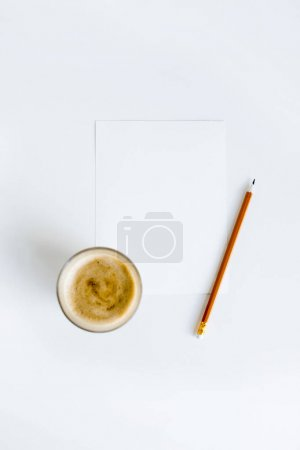 Coffee on paper with pencil