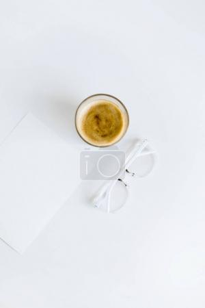 Cup of coffee with paper