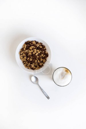 Glass of coffee and cornflakes