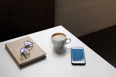 cup of coffee and smartphone
