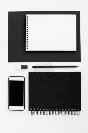 smartphone, notepads and office supplies