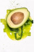 avocado with watercolor stains