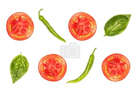 slices of tomato with peppers and basil