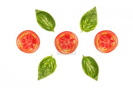 composition of tomato slices with basil leaves