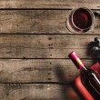 Top view of bottle of pink wine, corkscrew, winegl...