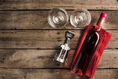 bottle of pink wine and wineglasses