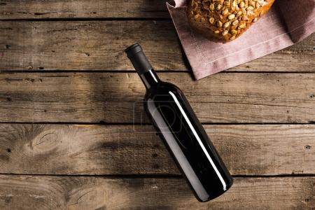 bottle of red wine and bread