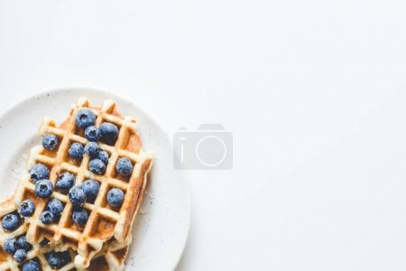 Photo for Pile of tasty fresh waffles with blueberries on plate - Royalty Free Image