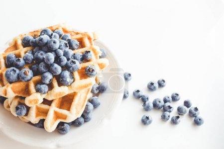 Photo for Plate of tasty stacked waffles with blueberries - Royalty Free Image