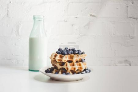 Photo for Delicious breakfast of stacked fresh waffles with blueberries and milk - Royalty Free Image