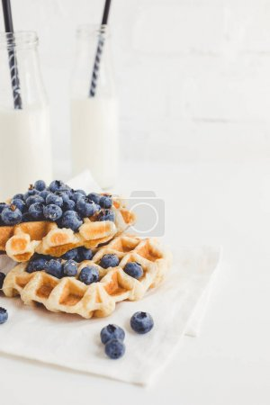 Waffles with blueberries and milk