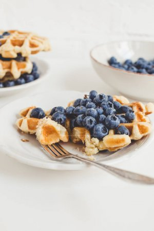 Photo for Composition of freshly baked waffles and blueberries for breakfast - Royalty Free Image