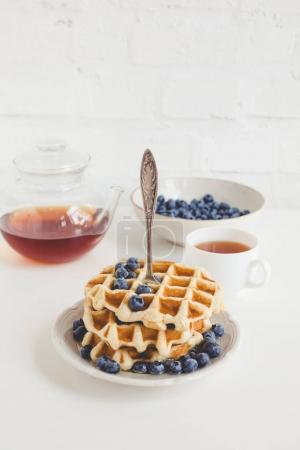 Photo for Tasty breakfast of waffles with blueberries and tea - Royalty Free Image